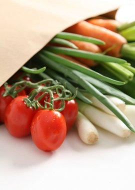Fresh vegetables in the paper bag