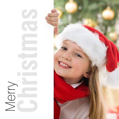 Beautiful young blonde girl in santa hat