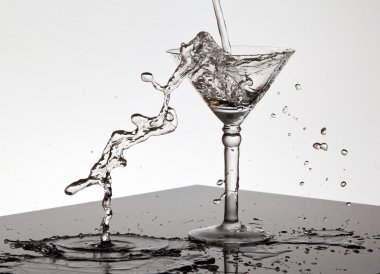 Water pouring into a Martini glass