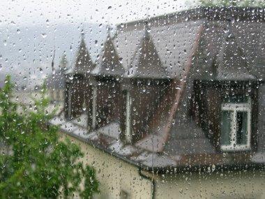 Through raindrops on the window