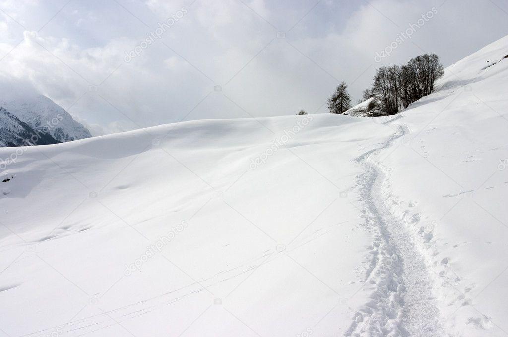 Winter mountain path in Swiss Alps