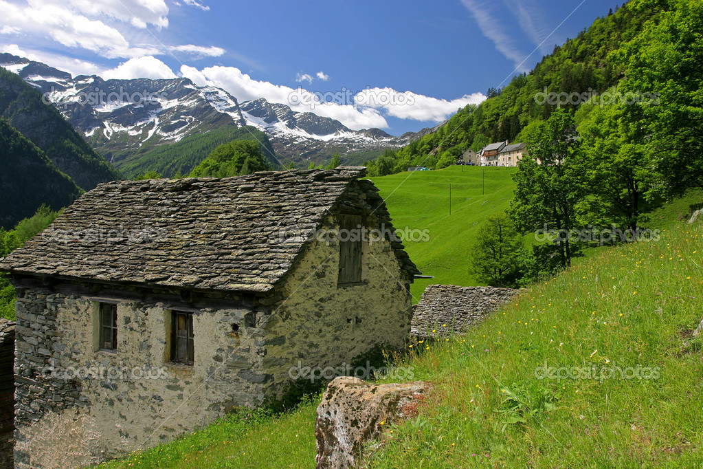 Aged stone house in Swiss Alps