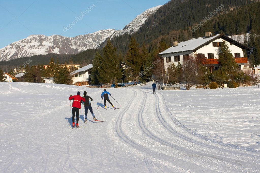 Crosscountry skiers on a track in Davos