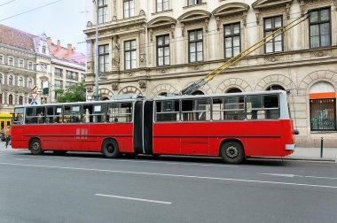 Red trolley-bus in Budapest (Hungary) from sideways stock vector