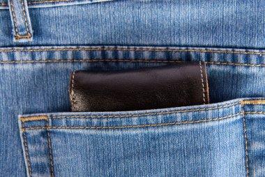 Wallet showing in back pocket of jeans