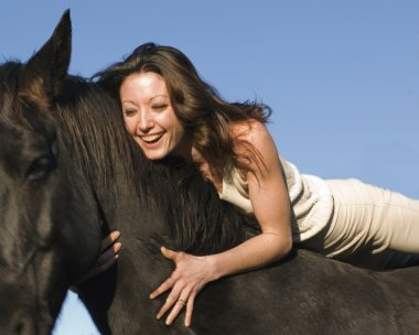 Laughing woman and stallion