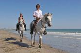 passeggiate a cavallo sulla spiaggia