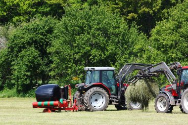Harvesting and wrapping hay