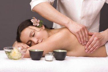 Masseur gettins massage beautiful woman