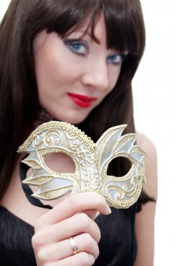Mysterious woman holding venetian mask