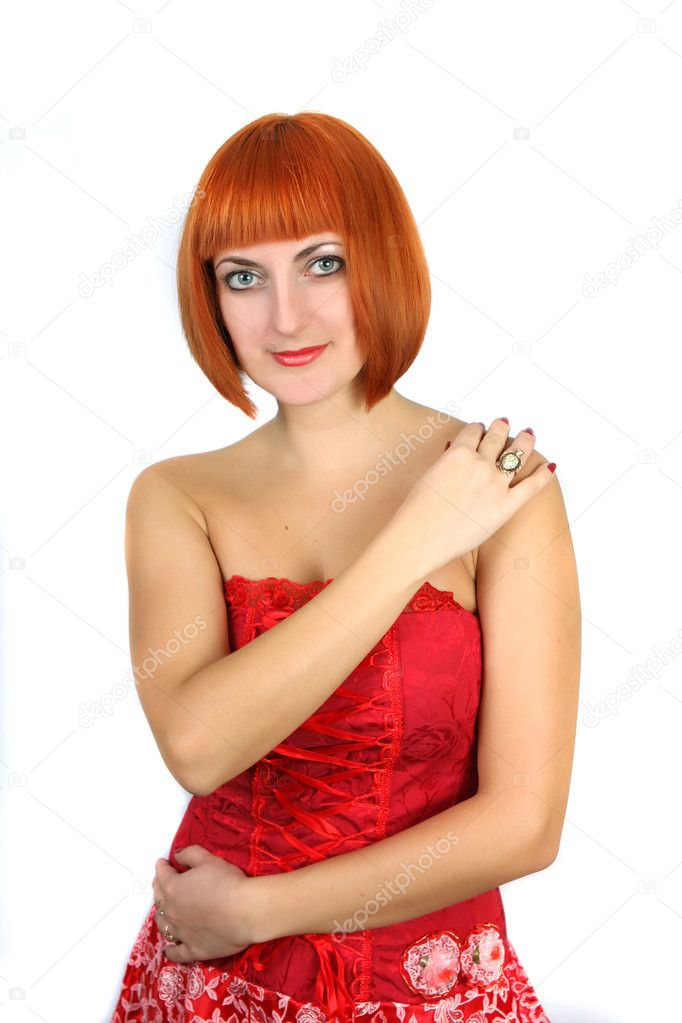 Young woman with red hair in a red dress