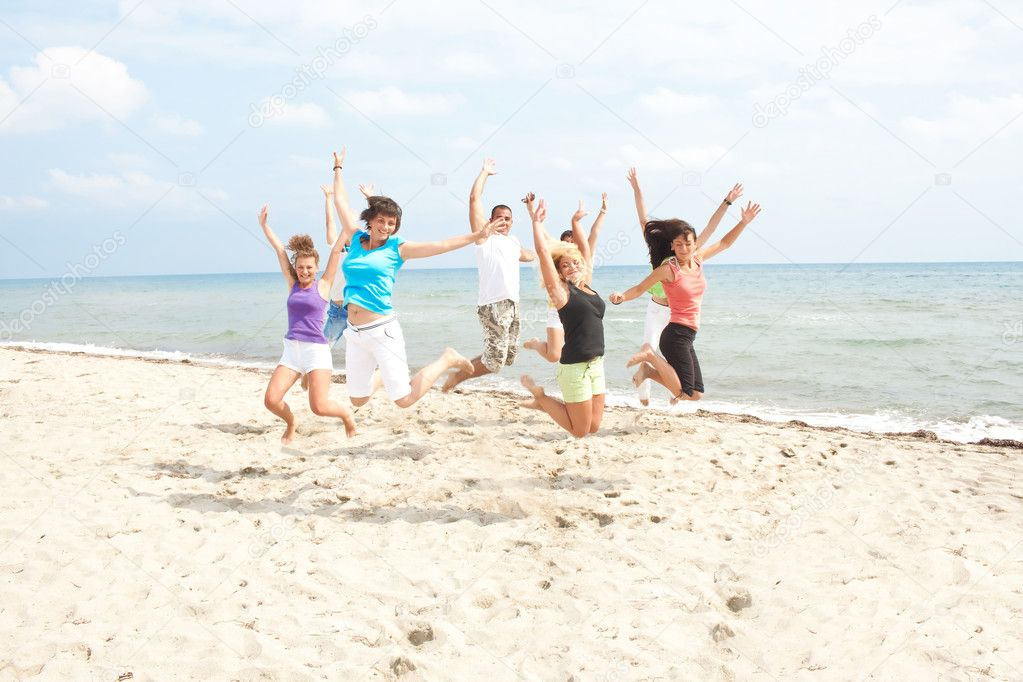 Happy jumping on the beach