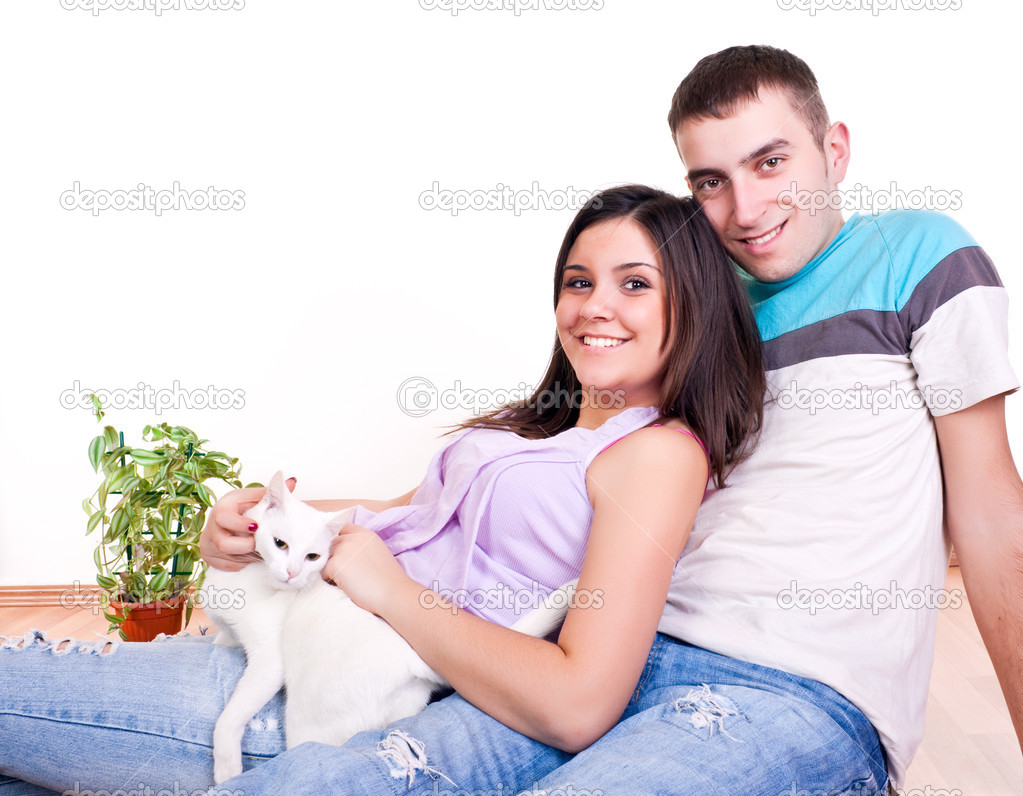 Young Couple On The Floor With Cat Stock Photo Luckybusiness 2450471