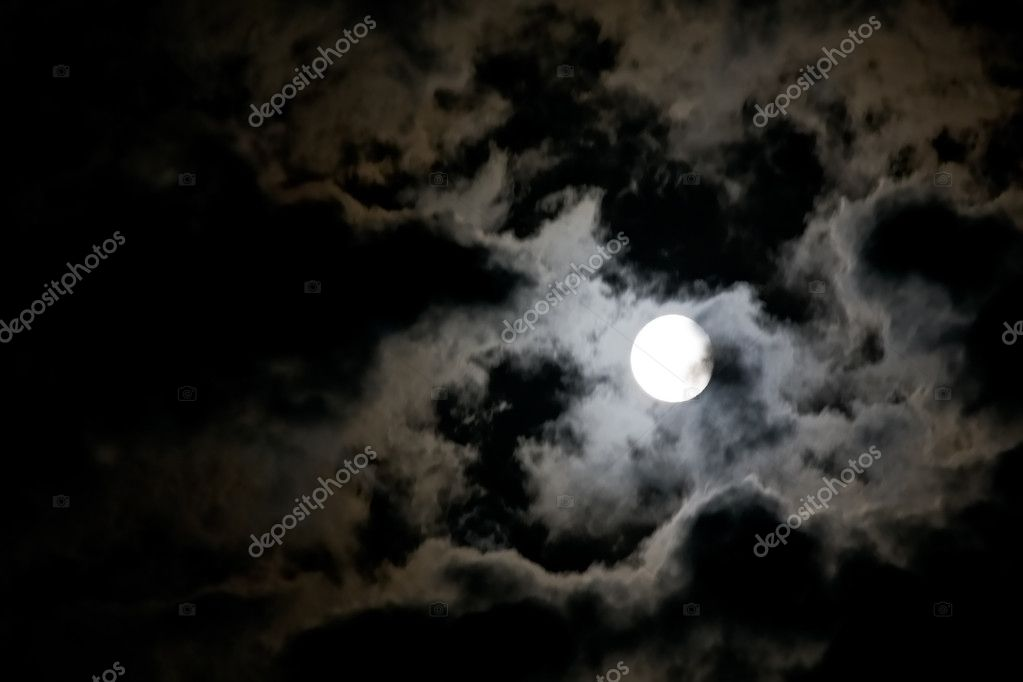 White full moon and eerie white clouds