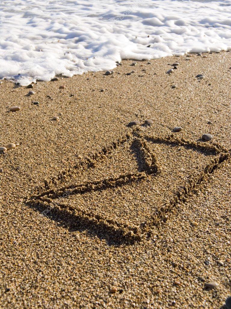 Envelope on wet sea sand