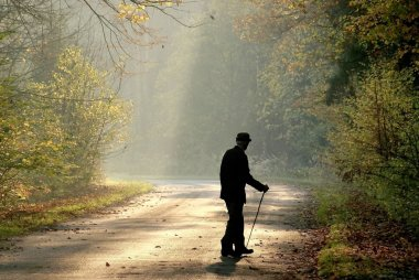 Older man through the country road