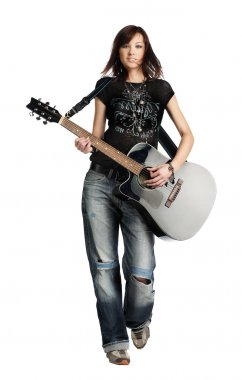 Teenager girl playing an acoustic guitar