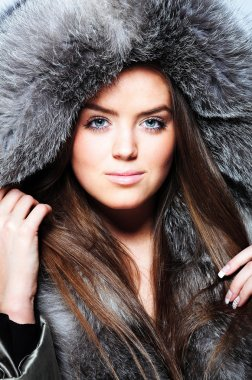 Beautiful girl wearing fur coat