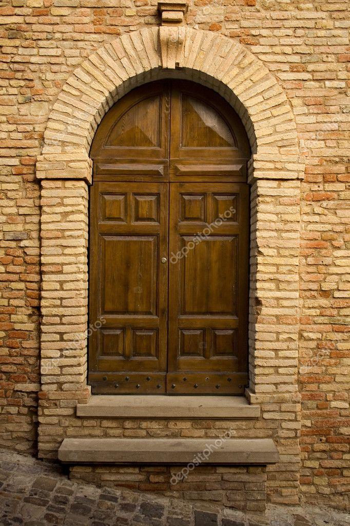 Wooden door in stone archway