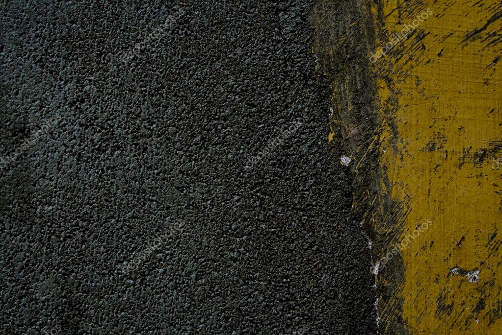 Black tarmac and yellow road marking