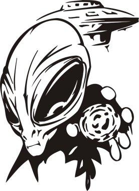 The alien shows an artefact.