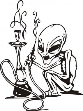 The alien smokes a hookah.