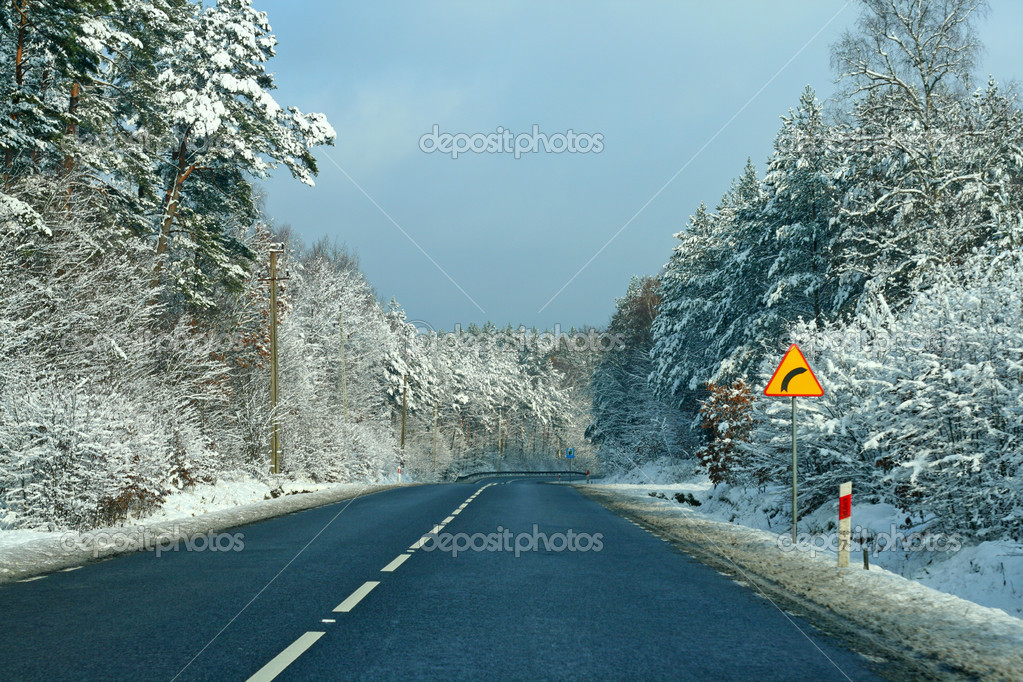 Road with curve ahead, winter time