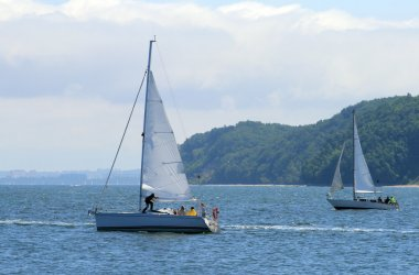 Two sailboats floating on the sea