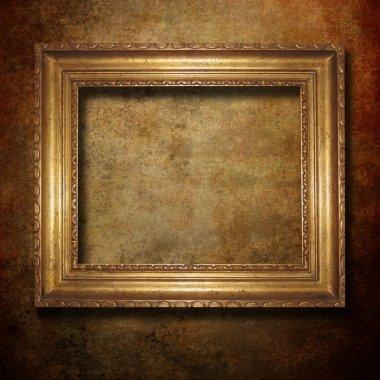 Golden frame over grunge paper