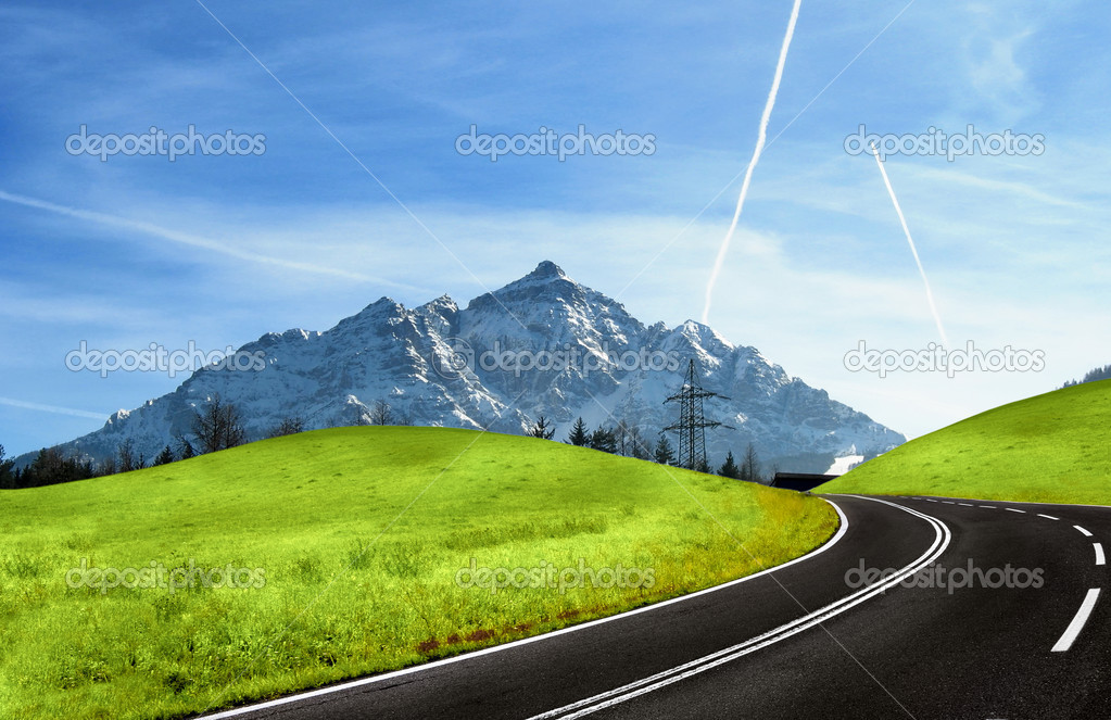 Mountain road and snowy Alps