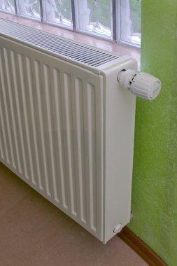 White radiator with radiator thermostat