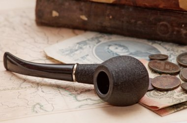 Old russian books smoking pipe and coin