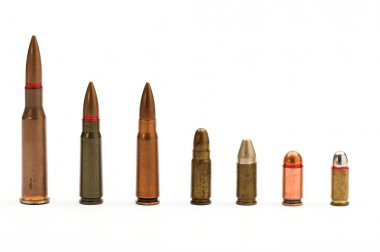 Bullets close up over white stock vector
