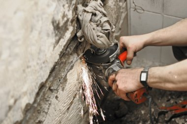 Angle grinder in use