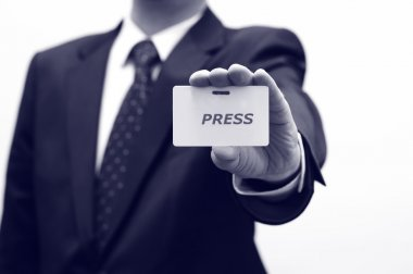 Journalist is holding press id