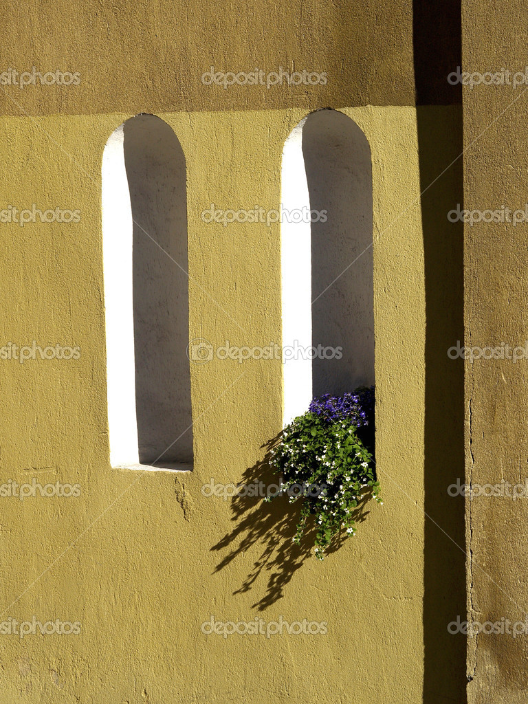 The wall with niches and flowers — Stock Photo © nekitt #1942212