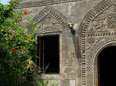 House stone wall with carving
