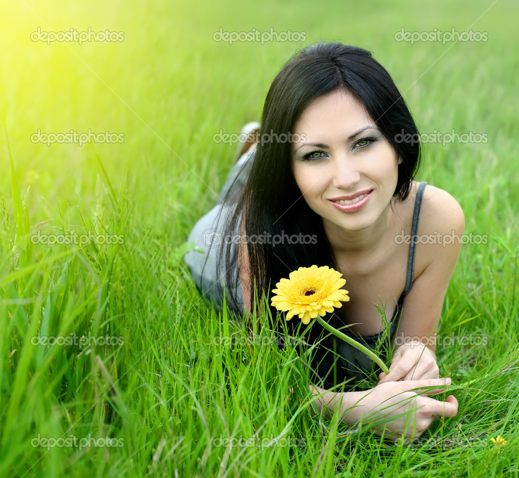 Beautiful woman in green grass