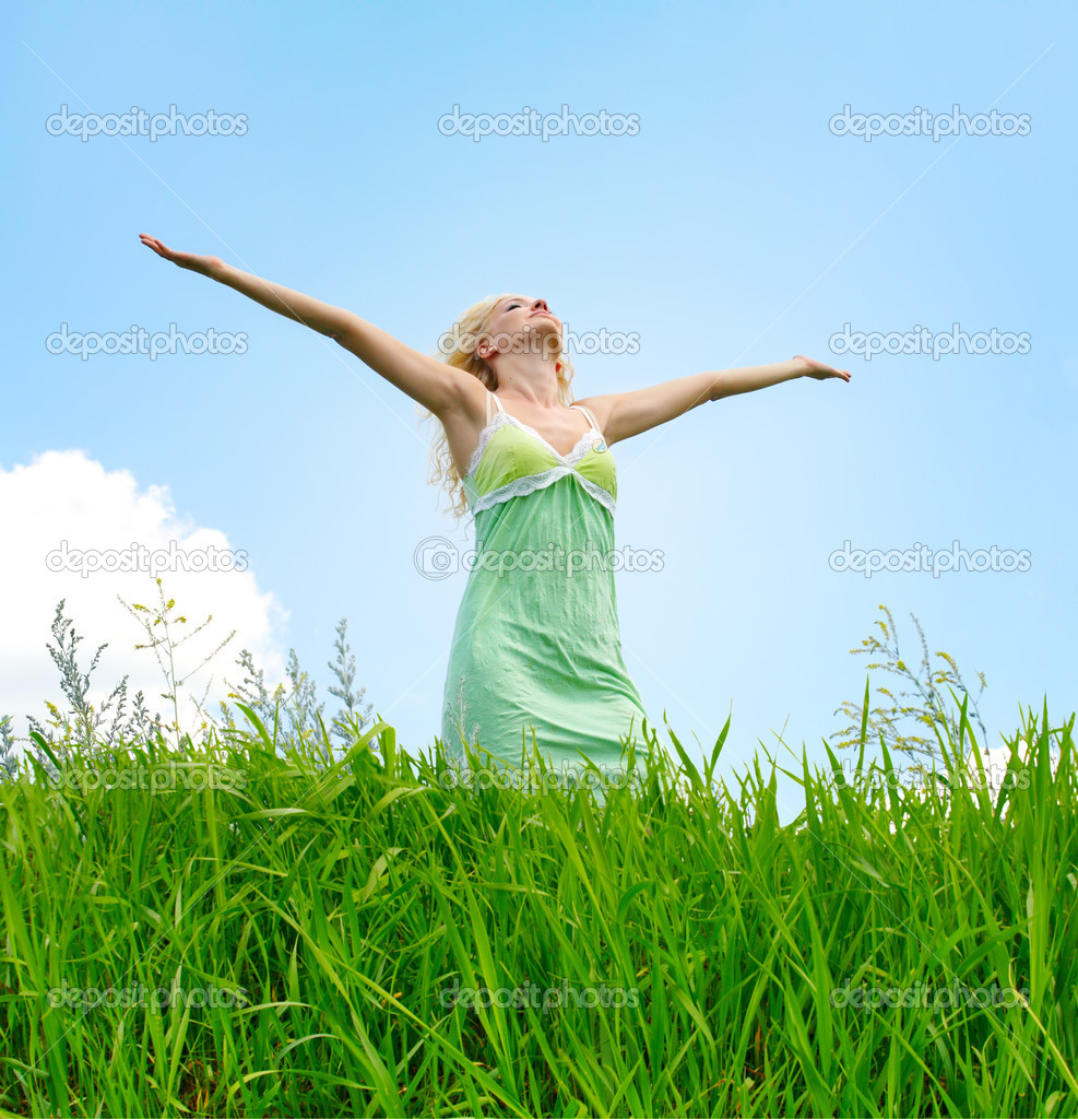 Young woman under blue sky