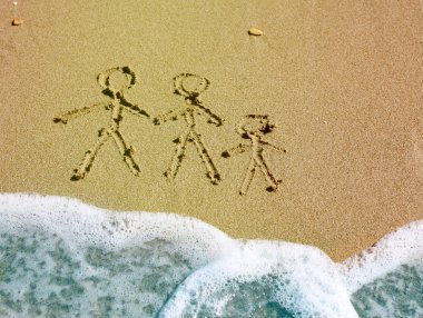 Family drawing on beach