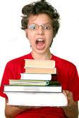 Fotografie šokovaný chlapec s soubor knih