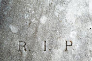 R.I.P. lettering on vintage grave
