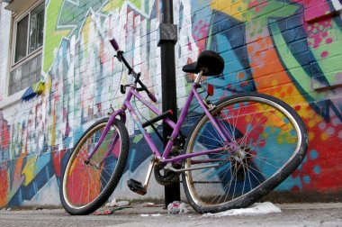 Street graffiti wall parked bycicle