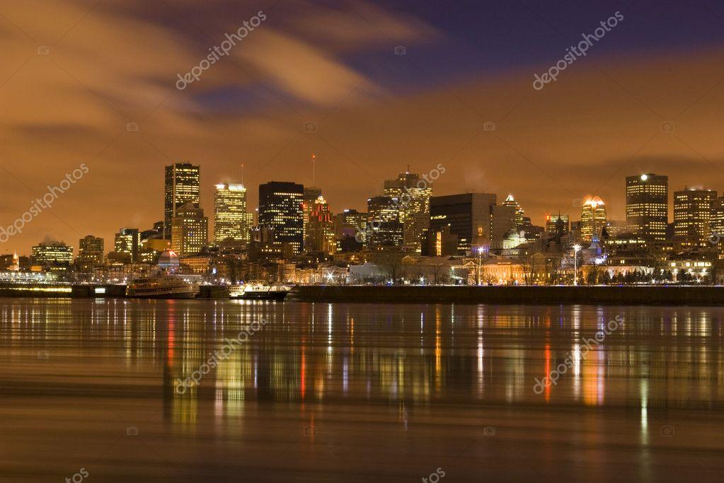 Cityscape night Montreal river reflectio