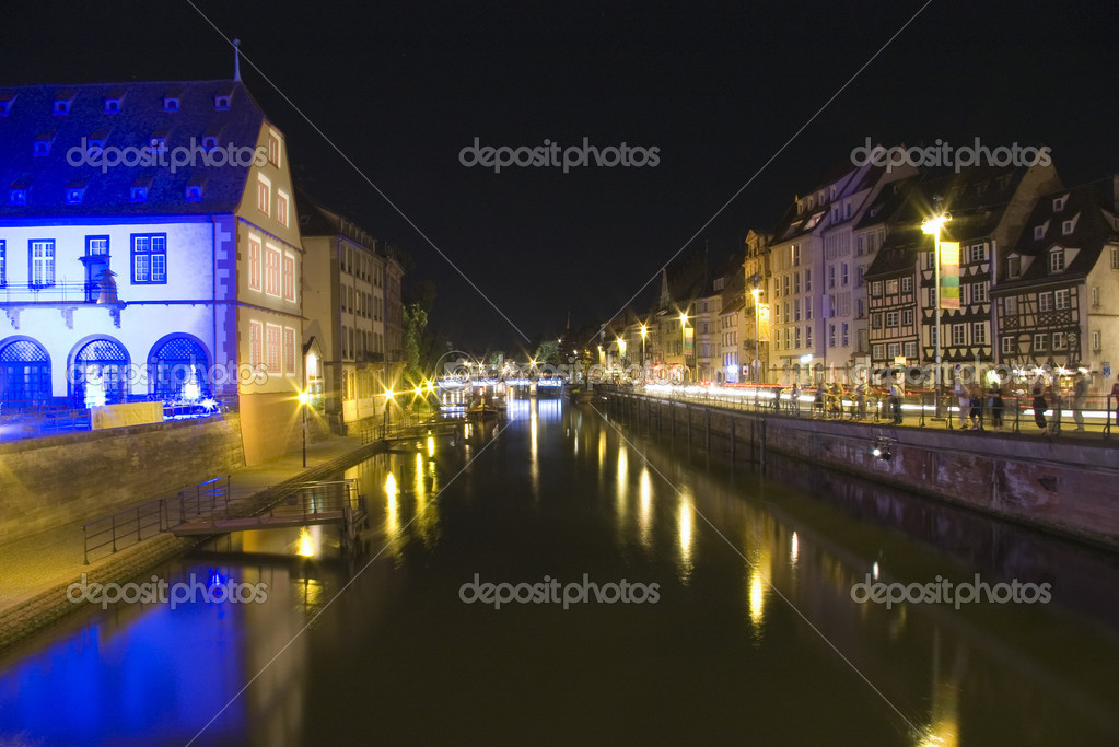 Bridge and quay in old town by night