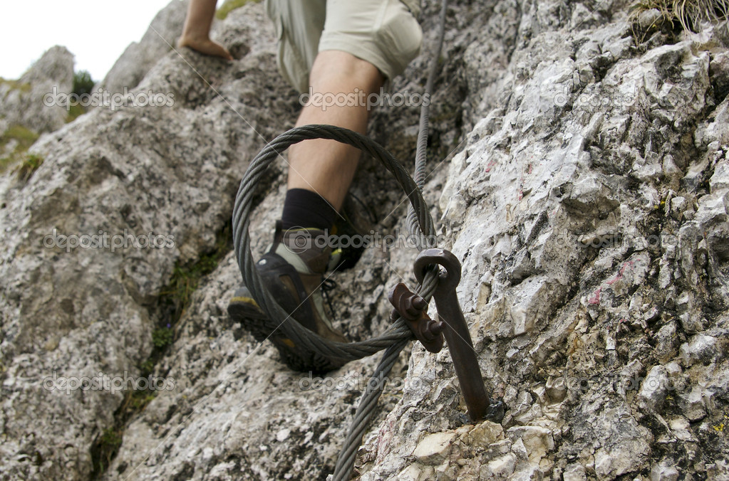 Safety cable on hiking mountain trail