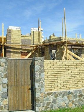 Door, fence and building area