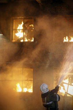 Fireman fighting a fire. Burning man