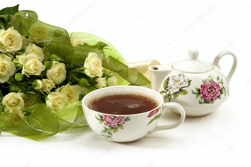White roses bouquet and tea