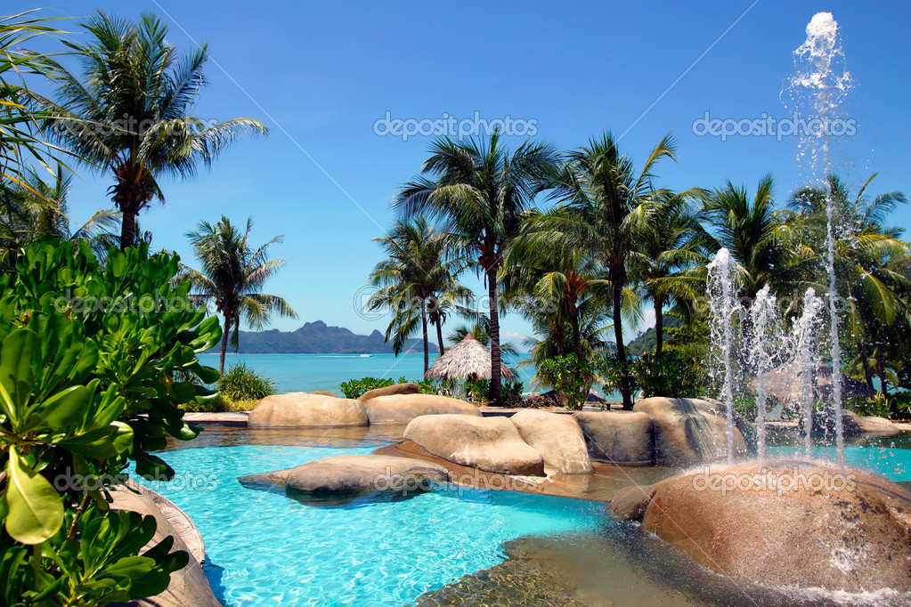 Swimming pool and tropical beach